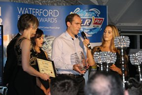 Greg Tuohy accepting award for Customer Service Excellence at the Waterford Business Awards
